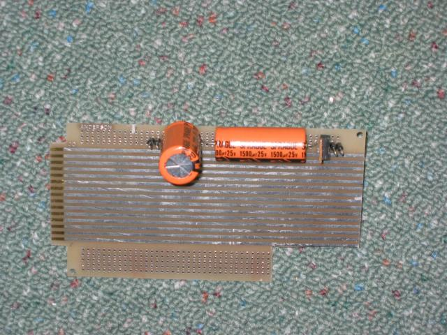Small PCB containing the power supply